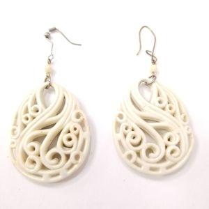 Ornate bone carving oval earrings